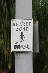 Shared zone sign between pedestrians, bicycles and steam trains? (philip.mallis) Tags: brisbane romastreetparklands park sign