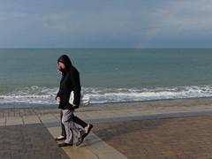 rainbow (watcher330) Tags: aberystwyth man woman sea promenade rainbow