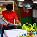 Shop owner reading the morning paper at Warorot Market in Chiang Mai, Thailand