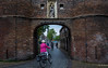 2018 - Delft - Eastern Gate (Oostpoort) (Ted's photos - For Me & You) Tags: 2018 cropped delft nikon nikond750 nikonfx tedmcgrath tedsphotos vignetting easterngateoostpoort delfteastgate eastgatedelft rider bicycle bike brickwall arch people peopleandpaths pathsandpeople stcatherinesgate delftstcatherinesgate stcatherinesgatedelft