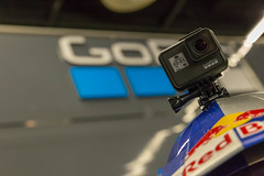 Red Bull Helm mit GoPro Hero 7 Action Kamera (verchmarco) Tags: photography messe kölnmesse köln 2018 cologne photokina autoracing autorennen race rennen championship meisterschaft competition wettbewerb action aktion track spur vehicle fahrzeug transportationsystem transportsystem blur verwischen noperson keineperson technology technologie business geschäft travel reise street strase car auto soccer fusball football computer signalise signalisieren flagsignal painting fountain herbst harbour hill spider national cielo pet tower