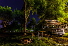 RVing through Canada (Stephan Neven) Tags: cruisecanada koa quebec rv camper fireplace picnic table grass tree evening night blue star campsite camping canada outdoor holiday landscape