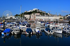 Torquay Marina (gillybooze) Tags: ©allrightsreserved vista architecture sea boats yacht mast reflections buildings sky pier jetty outside seascape outdoor water vessel shadows vehicle wheel boat bay mountain hill building outboardengine port torquay