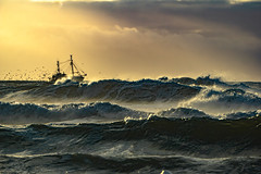 stay with me (Wöwwesch) Tags: sunset fishing waves coast beach ocean sky boat