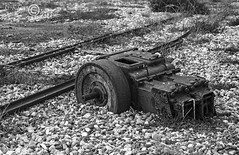 Things Left Behind (23) (Dungeness)-03278 (G.K.Jnr.) Tags: landscape historic foliage vegetation deserted desolate discarded delapidation winch machinery railwayline seaside beach shingle outdoor scenic interest touristattraction monochrome bw blackandwhite blackwhitephotos rural dungeness romneymarsh kent unitedkingdom fujix apsc xh1