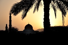 A Land of Contradictions (The Spirit of the World ( On and Off)) Tags: oman mosque minerets islam muslim religion palm trade tree palmtree sultanqaboosmosque hilside muscat sun sunrise landscape peaceful