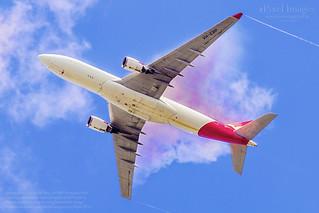 Qantas Airbus A330-202 Reg. VH-EBP 'Ningaloo Reef' condensation curtain forming behind the wings