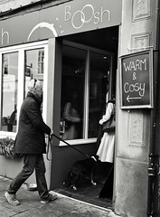 Warm and Cosy Boosh (Bury Gardener) Tags: bw blackandwhite monochrome mono england eastanglia uk britain burystedmunds suffolk streetphotography street streetcandids snaps strangers candid candids people peoplewatching 2018 nikond7200 nikon abbeygatestreet