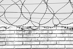 urban landscape-9 (Rino Alessandrini) Tags: fence backgrounds barbedwire pattern boundary abstract blackandwhite old wallbuildingfeature nopeople textured outdoors architecture prison rough white constructionindustry everypixel
