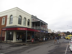 Bendigo Bank and Pharmacy, Mostyn St, Castlemaine (d.kevan) Tags: streetscenes mostynst decorativedetails shops businesses restaurants cafés castlemaine people trees victoria bendigobank pharmacies banks signs seats verandahs cars