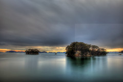 Matsushima bay sunset (Elios.k) Tags: horizontal outdoors nopeople island hikitoshijima senganjima yokuurajima fukuuraisland fukuurajima pinecovered scenicview matsushimabay sea water rocks calm reflection serenity calmness sunset sunsetcolours trees pinetree sky clouds cloudy weather longexposure movingclouds ndfilter hdr highdynamicrange seascape colour color travel travelling vacation canon 5dmkii camera photography december 2017 matsushima sendai miyagiprefecture tōhokuregion tohoku honsu asia japan