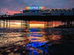 Rainbow Brighton Palace Pier Sign (lomokev) Tags: england unitedkingdom gb brighton pier brightonpier palacepier rainbow reflection sunset dusk westpier olympusomdem5 olympus omd em5 olympusomd wildswimming swimming