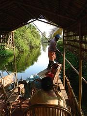 Oarsman Navigating (jameswoo2) Tags: reeds backwater kerala india boatman canal reflections