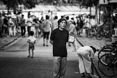 Stroll (petemenzies.com) Tags: man blackandwhite bw streetportrait streetphotography bokeh crowd people vietnam travel asia hoian stroll
