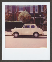 0017 Tiny (romain@pola620) Tags: pola polaroid film pellicule analog analogue argentique square carré londres london uk greatbritain angleterre itype impossible impossibleproject originals one onestep onestep2 low lowfi car voiture old urban urbandetail white blanc nobodyishere nobodyisthere nobody street rue alone hackney