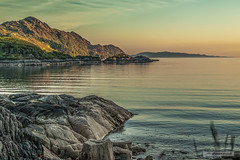 "Ardnish and Ardnamurchan Peninsulas  in a summer sunset from Loch nan Uamh. (Scotland by NJC.) Tags: scotland ardnishpeninsula lochnanuamh westcoastofscotland arisaig coastline 海岸线 litoral côte küste linea costiera 海岸線 해안선 seashore coast shore seaboard seaside beach strand sunset nightfall dusk sundown gloaming twilight غُرُوبُ الشَّمْس ""pôr do sol"" 日落 ""zalazak sunca"" ""západ slunce"" solnedgang zonsondergang crepúsculo auringonlasku ""coucher de soleil"" sonnenuntergang ηλιοβασίλεμα tramonto ""zachód słońca"" apus ""закат солнца"" solnedgång peaceful calm still quiet serene undisturbed gentle pleasant soothing tranquil placid restful pacífico 和平的 miran"