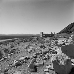 Ruins Rhyolite , NV (poavsek) Tags: nevada ilford blackwhite film hasselblad zeiss cf40mm rhyolite deathvalley ghosttown