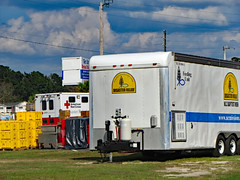 Food Distribution Center. (dccradio) Tags: lumberton nc northcarolina robesoncounty outdoor outdoors outside sky bluesky cloud clouds cloudformation september sunday afternoon fall autumn hydepark hydeparkbaptistchurch hurricaneflorence reliefstation disasterrelief naturaldisaster hurricane florence trailer ncbaptists baptistmen baptistsonmission grass lawn yard ground dirt sand containers container redcross americanredcross canon powershot elph 520hs
