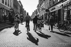 Shadows in Gouda (PaulHoo) Tags: fujifilm x70 gouda city candid people citylife 2018 sun blackandwhite shadow backlit light contrast streetphotography