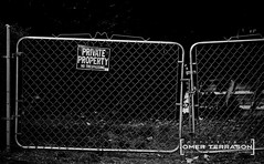 Signage - 81 (oterrason) Tags: sign signage signs warnings disclaimers bills posted rules laws curbs rights announcements posts post fuji fujifilm xpro2 fujifilmxpro2 fujinon fujinon10cmf2ltm ltm m39 gates fences demarcation fence gate steel wire claim trespass illegal caution blackandwhite monochrome lowkey ltmtomadapter mmountadapter adaptedlens vintagelens classiclens manuallens