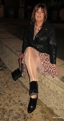 Resting on the prom (janegeetgirl2) Tags: transvestite crossdresser crossdressing tgirl tv ts heels nylons glamour ankle boots summer shirt dress jane gee outside promenade brighton leopard biker jacket black