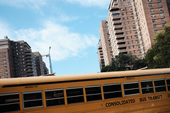 Seward Park Coop Buildings and a Yellow School Bus (Zach K) Tags: seward park sewardpark coop cooperative ownership housing multifamily residential tower yellow school bus schoolbus yellowschoolbus les lower east side nyc blue sky angles lines geometry fujifilm fuji 23mm xt2 fujifilmxt2 xf23mmf2 xf23mm20 23mm20