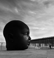 (Greg Adams Photography) Tags: madrid spain baby head bw colorblind monochrome blackandwhite man sky clouds trainstation europe travel hhsc2000 sculpture