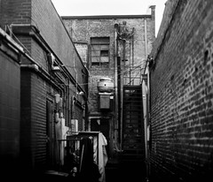 Back Alley (jeffcharles93) Tags: city street walking wall stairs blackwhite building umbrella escape architecture