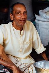 Indian Shopkeeper, Baldeo Uttar Pradesh (AdamCohn) Tags: 018kmtobaldevinuttarpradeshindia adamcohn baldeo baldev india uttarpradesh geo:lat=27408425 geo:lon=77822235 geotagged holi man portrait shopkeeper street streetphotography vendor wwwadamcohncom