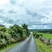 Rising Road Ireland (Sean P. Sweeney) Tags: ireland country road clouds wall stonewall