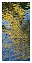 Abstract photograph of reflections and ripples in a pond. (andypf01) Tags: abstract water pond reflections ripples willowtrees sky colour yellow green blue whiteborder nature autumn iphone xs