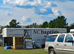 NC Baptists Trailer. (dccradio) Tags: lumberton nc northcarolina robesoncounty outdoor outdoors outside sky bluesky cloud clouds cloudformation september sunday afternoon fall autumn hydepark hydeparkbaptistchurch hurricaneflorence reliefstation disasterrelief naturaldisaster hurricane florence trailer ncbaptists baptistmen baptistsonmission grass lawn yard ground tree trees foliage greenery box boxes supplies yukon gmc canon powershot elph 520hs