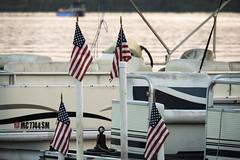 End of Summer (DJ Wolfman) Tags: lake lincolnlake michigan water flag america pontoon boats olympus omd em5markii zuiko 14150mm