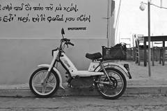 Vogue (Ren-s) Tags: olympus em10 mobylette moped scooter moto wall mur black white bnw bw noir blanc nb noiretblanc noirblanc blackandwhite blackwhite contrast street streetphotography graffiti words mots tag vogue greek grècque grèce greece europe light lumière new summer été 2018 rue