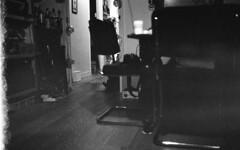 Scruff light (Arne Kuilman) Tags: ilford delta400 id11 homedeveloped mystery film scan 1200dpi epson v600 930minutes nikon fe2 28mm amsterdam livingroom light dark fingerprint