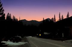Cooke City Twilight (wyojones) Tags: montana cookecity beartoothhighway us212 night lowlight absarokamountains twilight trees car road highway