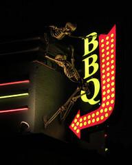 Rib night? (Reva G) Tags: halloween decoration bbq barbecue skeleton bones skull sign neon northvancouver northshore smokebones restaurant arrow red yellow silly