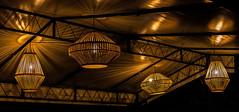 rays (karwinho) Tags: lamp openwork geometry lines light shadow reflection dark night evening ceiling hanging lightbulb design fancy club restaurant ornamental wooden shape