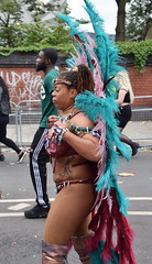 DSC_8414a Notting Hill Caribbean Carnival London Exotic Colourful Maroon Costume With Maroon Turquoise and Ping Feather Headdress Girls Dancing Showgirl Performers Aug 27 2018 Stunning Ladies (photographer695) Tags: notting hill caribbean carnival london exotic colourful costume girls dancing showgirl performers aug 27 2018 stunning ladies maroon with turquoise ping feather headdress