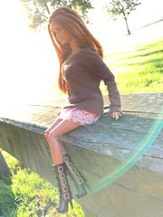 Sweater weather. (dolldudemeow24) Tags: barbie fashionistas cln69 doll 2015 red hair ginger pink sweet cute brown sweater skirt boots fall autumn fashion collection bench wood trees sunlight rays of light blue sky morning grass 2018
