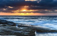 A Moody Sunrise Seascape (Merrillie) Tags: daybreak theskillion nature australia terrigal rocky morning sea waterscape newsouthwales rocks earlymorning nsw coast landscape ocean dawn cloudy sunrise coastal clouds outdoors seascape waves centralcoast water sky