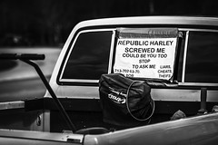 Republic Harley Screwed Me (Mabry Campbell) Tags: harriscounty houston texas usa unitedstatesofamerica blackandwhite car image photo sign truck f35 mabrycampbell march 2018 march22018 20180302downtowncampbellh6a2120 100mm ¹⁄₁₆₀₀sec 100 ef100mmf28lmacroisusm
