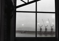 trois petites grues (asketoner) Tags: harbour port marseille france window through sky sea crane