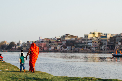 Mother Walking Son Along Riverbank, Mathura India