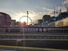 A SWR Class 159 at London Waterloo with the sun setting behind the London Eye in the background. (Conner Nolan) Tags: londonwaterloo southwesternrailway class159 londoneye