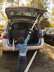 Tilting at minivans (quinn.anya) Tags: sam kindergartener sword minivan car renfaire renaissancefaire norcalrenfaire northerncaliforniarenaissancefaire
