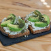 Toast with ricotta, dill and avocado served on stone serving plate