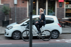 A Dutch Girl Riding on a Bicycle, De Pijp, Amsterdam, the Netherlands, Europe (takasphoto.com) Tags: amsterdam bewegingsonscherpte bicicleta bicycle bicyclette bike cycle dutche europe fahrrad floucinétique fuji fujixe3 fujixe3fujifilm fujifilm fujifilmxe3 fujinon fujinonxf60mmf24r fujinonxf60mmf24rmacro gente girl girls holland human humanbeing longexposure macro macrophotography mirrorless mosso motion motionblur mujer mujeres nederland netherlands niña niño people paísesbajos persona photography photographytechnique rörelseoskärpa transport transportation travel travelphotography trip vehicle viaje westerneurope woman women xe3 xtranscmosiii xtransiii blonde blond