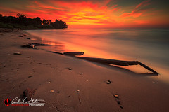 Bradford Fire (andrewslaterphoto) Tags: bradfordbeach clouds greatlakes lakemichigan landscape landscapes longexposure milwaukee sand sunrise wisconsin unitedstates us sky fire branch wood nature water waves mke mkemycity discoverwisconsin travelwisconsin canon leefilter