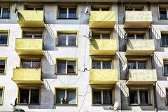 3 zonder (roberke) Tags: windows ramen vensters balkons balcony sun zonlicht zonnig schaduw shadow architecture architectuur geel yellow schotelantenne satellitedish gebouw building gevel facade